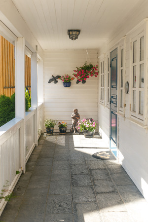 White typical wooden terrace with entrance door, Norway photo