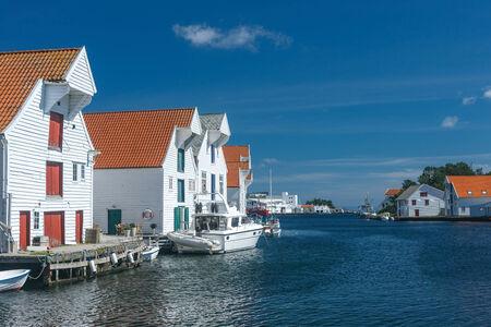 world heritage site: Skudeneshavn village in Norway, white wooden houses