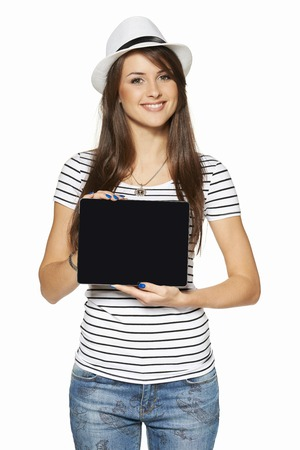 Woman showing tablet computer screen smiling wearing straw hat isolated on white . photo