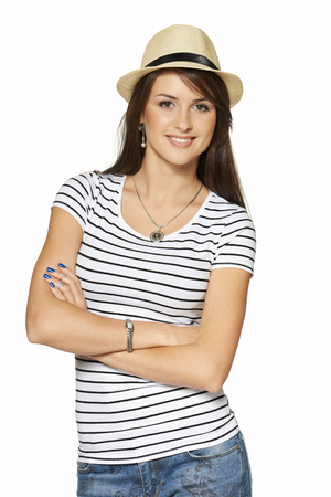 gratified: Smiling young woman in stripped tshirt and straw hat with folded hands looking at camera, isolated on white . Stock Photo