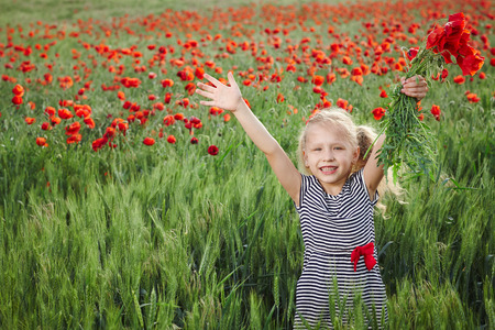 outspread: Little girl on the poppy meadow greeting happy with hands outspread