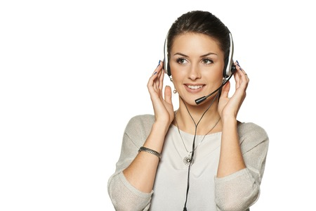 blank center: Headset woman call center operator smiling looking at blank copy space, against white background