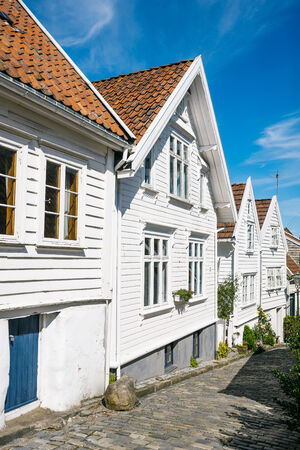scandinavian landscape: Street with white wooden houses in old centre of Stavanger, Norway. Tourist attraction