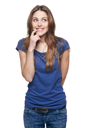 prank: Portrait of a funny young woman with prank expression on her face, looking up Stock Photo