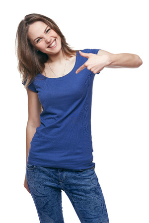 Smiling woman pointing at herself cheering happy photo