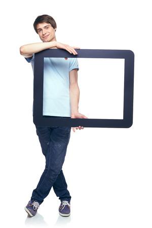 Full length man holding tablet frame, over white background