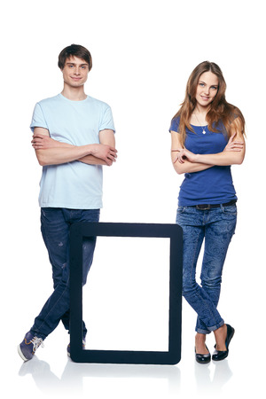 Full length couple standing with tablet frame, over white background photo