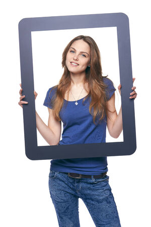 Smiling woman holding tablet frame, over white background photo