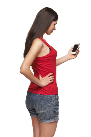 Rear view of a woman with mobile phone, over white background photo