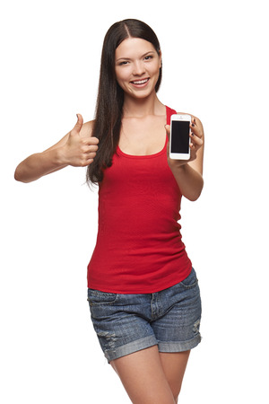 Happy smiling woman showing cell phone with black screen and gesturing thumb up, on a white background