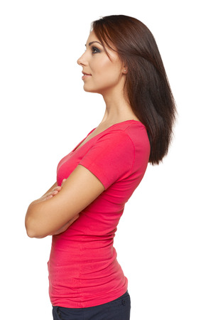 Side view full length of beautiful brunette woman looking forward over white background