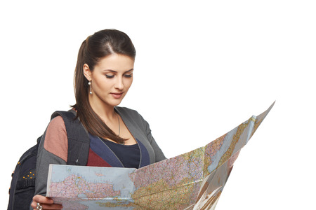 tourist destination: Happy woman holding a map - isolated over a white background