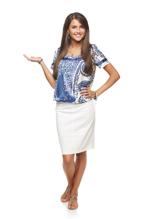 Full length of beautiful elegant woman showing holding on the palm blank copy space over white background