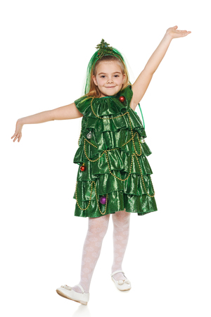 christmas costume: Funny 7 years old girl in Christmas tree costume feeling happy with hands outspread, over white background