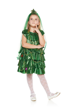 envisioning: Thinking 7 years old girl in Christmas tree costume looking up at blank copy space, over white background