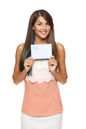Surprised happy woman showing blank envelope banner, over white background.