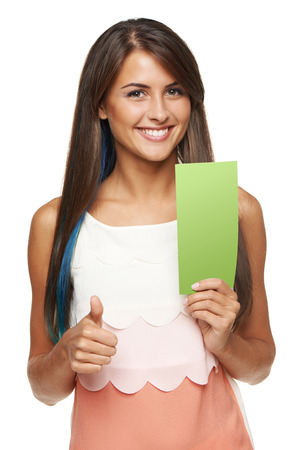 Closeup of young woman holding a green banner ad and gesturing thumb up, over white background photo