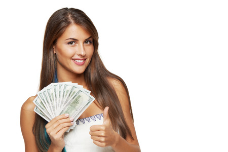 私たちと若い美しい女性のクローズ アップ手で身振りで示すこと親指、コピー領域の白い背景の上ドルお金 写真素材