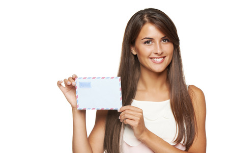 missive: Closeup of happy smiling woman showing blank avia envelope, over white background.