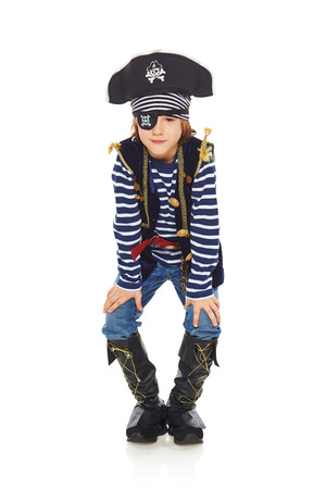 Full length grinning little boy wearing pirate costume, over white background