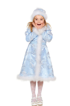 little girl surprised: Surprised little girl wearing blue suit of snow maiden standing in full length, over white background Stock Photo