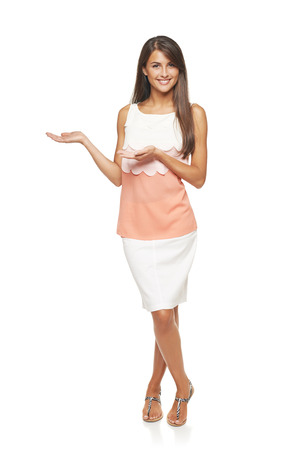 Full length of elegant business woman showing holding on the palm blank copy space over white background
