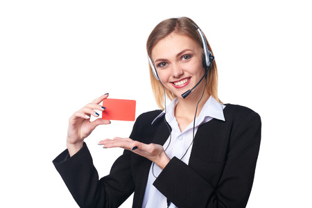 blank center: Friendly female helpline operator showing blank credit card over white background