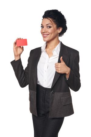 approving: Smiling african american business woman showing blank credit card and giving approving sign, over white background Stock Photo