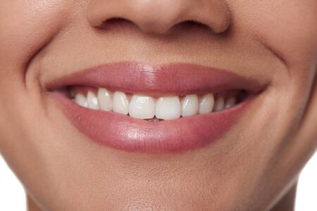 front teeth: Cropped of beautiful young woman smile. Dental health.