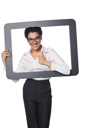 approving: Happy smiling business woman looking through frame and showing approving gesture, over white background