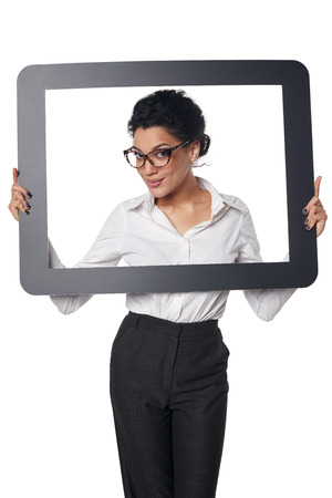looking through frame: Smiling business woman looking through frame, over white background