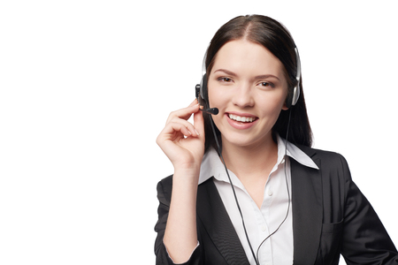 sales occupation: Closeup portrait of smiling attractive woman with headphone isolated against white , with copy space
