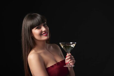 anniversary sexy: Sensual smiling woman holding cocktail glass. Closeup portrait with copy space Stock Photo