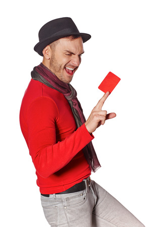excited: Excited trendy man screaming of joy showing blank credit card over white background