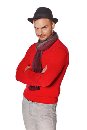 brooding: Portrait of male standing with folded hands stared with brooding eyes, looking at the camera Stock Photo