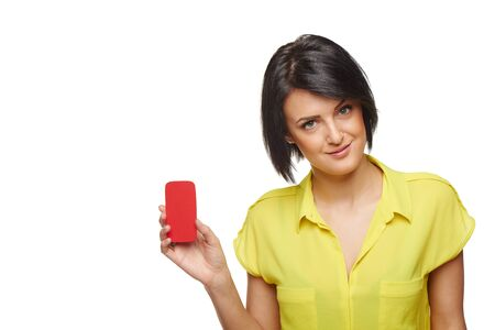 Confident beautiful woman showing blank card in hand, horizontal shot with copy space, over white background Stock Photo