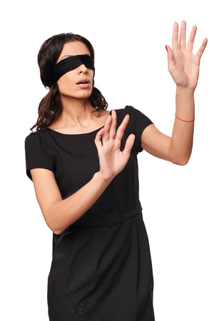 Businesswoman in blindfold walking with hands forward isolated on white background