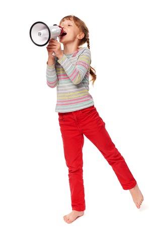 Full length happy little girl screaming in loudspeaker, over white background