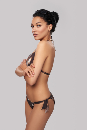 beautiful body: Fashionable mixed race african american - caucasian woman in brown swimsuit