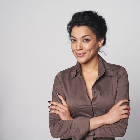 serious: Portrait of smiling african american business woman looking confident and relaxed Stock Photo