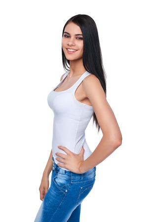 cute teen: Portrait of smiling casual teen girl with hand on hips, isolated on white background Stock Photo
