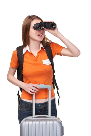 over white: Portrait of a young teen girl looking through binoculars and searching, over white background Stock Photo