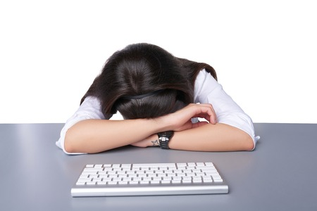 workaholic: Young businesswoman asleep on her laptop at work Stock Photo