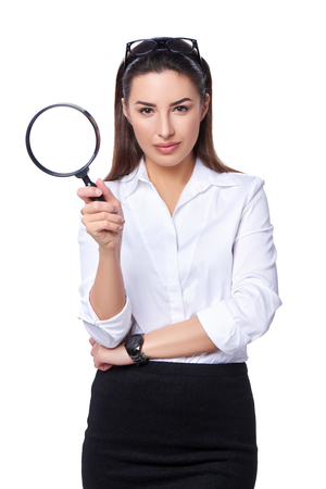 analyzing: Business search concept. Business woman holding magnifying glass, isolated over white