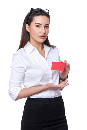 confident woman: Portrait of young confident business woman showing credit card isolated on white background