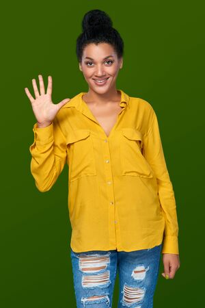 finger teen: Hand counting - five fingers. Happy mixed race african american - caucasian woman showing five fingers