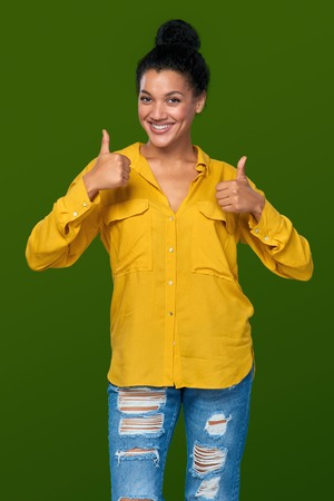 one person: Happy mixed race african american - caucasian woman giving you double thumb up Stock Photo
