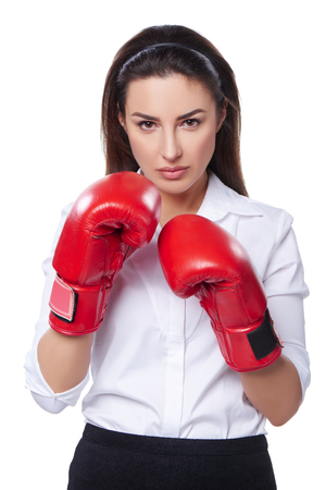 intimidating: Strength, power or competition concept. Businesswoman wearing boxing gloves ready to fight, isolated on white background.
