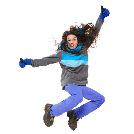 white people: Young woman in winter sport clothing jumping isolated on white background Stock Photo
