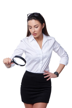 concentrated: Business search concept. Concentrated business woman looking through magnifying glass Stock Photo